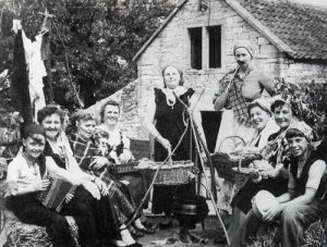 Women's Institute Carnival Float for a village fete in the 1950s. Left to right are: Andrew Pickford, Margaret Pickford, Kitty Hodder, Isobel Tucker, Ivy Tucker, unknown, Winifred Watts, Betty Bridges, Vera Tompkins and Peter Tompkins.