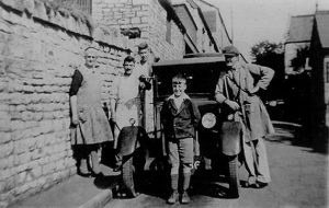 Abbott's Baker Shop at the bottom of Maggs Hill with the delivery van. Shown from left to right are Mrs Abbott, S Fry, Colin Abbott, Shilling Moon (front) and A Abbott.