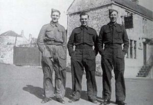 The Welsh Guards were stationed in Timsbury in 1940. Here standing outside The New Inn (The Guss and Crook).