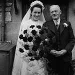 Doris Gladys Helps (nee Gregory) with her father Ernest Gregory at her wedding at The Tabor Chapel in 1950. The reception was held at Kingwell Hall.
