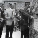 Bernard Cayzer laying the foundation stone of the Conygre Hall in 1973. Left to right are L Brewer (Chairman of the Development Committee), J Crozier (who designed and built the Hall) and Arthur Moon (Chair of the Parish Council). In the background is the old Miners' Welfare Hut.
